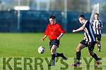 Robert Kerins of St Brendans Park tries to outpace Alex Hill of St Marys of Cork in the FAI Youths Cup game in Christy Leahy Park on Sunday.