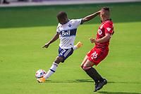 ORLANDO, FL - APRIL 24: Deiber Caicedo #7 of Vancouver Whitecaps kicks the ball during a game between Vancouver Whitecaps and Toronto FC at Exploria Stadium on April 24, 2021 in Orlando, Florida.