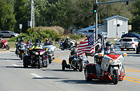 Members of the Patriot Guard lead a procession Tuesday, Sept. 14, 2021, during memorial and funeral services for 2nd Lt. Henry Donald Mitchell  in Fayetteville. Robert Mitchell, 90, of Fort Smith led a decades long effort to find the remains of his brother, whose plane went down July 8, 1944 over Austria during World War II, and have to them returned to Arkansas for burial. Visit nwaonline.com/210915Daily/ for today's photo gallery.<br /> (NWA Democrat-Gazette/Andy Shupe)