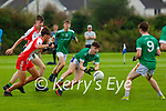 Donal Daly St Kierans gets his pass away under pressure from Jack O'Neill  West Kerry during their minor County Championship clash in Castleisland on Saturday