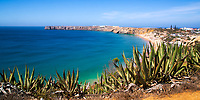Panorama on Mareta beach and Sagres fortress, over the turquoise Atlantic Ocean, in the beautiful, sunny Algarve region south of Portugal, Europe