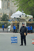 A policeman on duty outside Windsor Castle the day before the wedding of Prince Charles and Camilla Parker-Bowles.