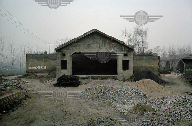 A disused community hall in the notorious 'Cancer Village' just outside Linfen, one of the most polluted cities in China. The village was nicknamed by Chinese news sites after the area's high rate of cancer-related illnesses (possibly caused by pollution from nearby industrial plants) was made known. Supplying a large part of the nation's energy, Shanxi is considered to be the centre of China's expanding coal industry.