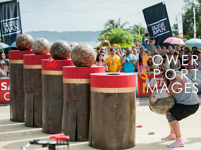 HAINAN ISLAND, CHINA - AUGUST 24:  Robert Oberst of USA competes at the Atlas Stones event during the World's Strongest Man competition at Yalong Bay Cultural Square on August 24, 2013 in Hainan Island, China.  Photo by Victor Fraile