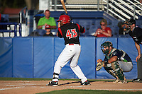 Batavia Muckdogs designated hitter Yuniel Ramirez (43) at bat in front of catcher Nick Collins (20) and umpire Ryan Wilhelms during a game against the Vermont Lake Monsters August 9, 2015 at Dwyer Stadium in Batavia, New York.  Vermont defeated Batavia 11-5.  (Mike Janes/Four Seam Images)