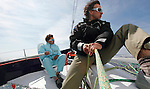 Onboard the MOD70 Race for Water, the first of the new series of oceanic one-design multihulls, skipper Steve Ravussin, Lorient, Brittany, France..Steve Ravussin.Eric Loizeau.
