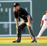 Umpire Jimmie Hollingsworth works a game between the Greenville Drive and Augusta GreenJackets on April 19, 2012, at Fluor Field at the West End in Greenville, South Carolina. (Tom Priddy/Four Seam Images)