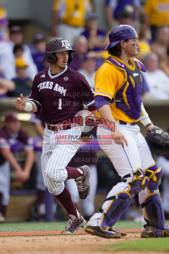 Texas A&M Aggies shortstop Blake Allemand (1) scores a run during the Southeastern Conference baseball game against the LSU Tigers on April 25, 2015 at Alex Box Stadium in Baton Rouge, Louisiana. Texas A&M defeated LSU 6-2. (Andrew Woolley/Four Seam Images)