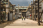 July 6, 2016. Greenville, South Carolina. <br />  Workers walk past the air and fuel heaters outside the Gas Turbine Technology Lab where the combustion cans of the turbines can be tested using different types fuels and fuel mixtures. As GE's clients have different needs for fuel to be burned in their turbines, the lab has a fuel farm that allows them to test various types of gas mixtures and be sure the turbines can handle the needs of the client.<br />  At the General Electric Gas Turbine factory, engineers  design, produce, test and repair gas turbines for generating electricity. These turbines weigh more than 900,000 pounds and can create internal combustion temperatures up to 2,900 degrees F. Depending on the model, one of the GE turbines can produce enough electricity for half a million American households.
