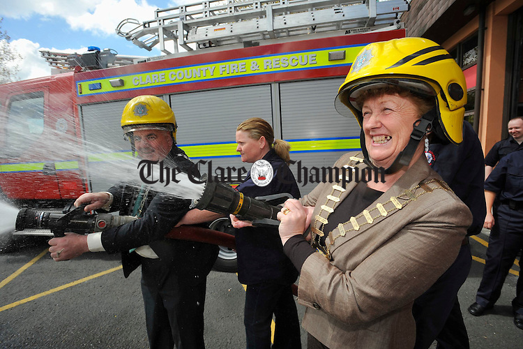 at the handover ceremony for a new Class B Fire appliance at Shannon Fire Station. Phoograph by John Kelly. The Mayors of Shannon and Clare Sean Mc Loughlin and Patricia Mc Carthy try their hands at firefighting following the handover ceremony for a new Class B Fire appliance at Shannon Fire Station. Phoograph by John Kelly.