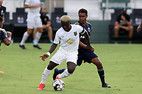 CARY, NC - AUGUST 01: Anderson Asiedu #6 is challenged for the ball by Pecka #7 during a game between Birmingham Legion FC and North Carolina FC at Sahlen's Stadium at WakeMed Soccer Park on August 01, 2020 in Cary, North Carolina.