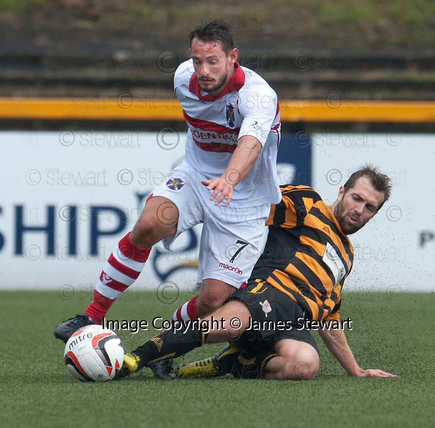 Stirling's Phil Johnston is challenged by Alloa's Graeme Holmes.