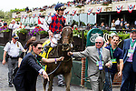 ELMONT, NY - JUNE 11: Julien R. Leparoux, aboard Carlina Mia, is led to the winners circle the Acorn Stakes on Belmont Stakes Day on June 11, 2016 in Elmont, New York. (Photo by Sue Kawczynski/Eclipse Sportswire/Getty Images)