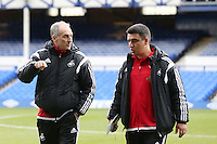 Swansea City Head Coach Francesco Guidolin and Swansea City Coach Gabriele Ambrosetti  pictured on the pitch ahead of the Barclays Premier League match between Everton and Swansea City played at Goodison Park, Liverpool