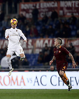 Calcio, Serie A: Roma vs Milan. Roma, stadio Olimpico, 12 dicembre 2016.<br /> Milan's Manuel Locatelli, left, heads the ball past Roma's Radja Nainggolan during the Italian Serie A football match between Roma and AC Milan at Rome's Olympic stadium, 12 December 2016.<br /> UPDATE IMAGES PRESS/Isabella Bonotto