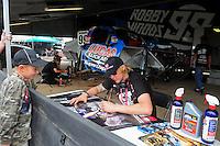 Mar. 20, 2011; Chandler, AZ, USA;  LOORRS pro two driver Robby Woods signs autographs during round two at Firebird International Raceway. Mandatory Credit: Mark J. Rebilas-