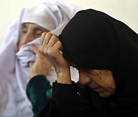 """Palestinian women react during the funeral of Hamas militant Ghassan Al-ailah, 22, who was killed by Israeli forces, in the Jebaliya refugee camp, northern Gaza Strip, Tuesday, Nov. 27, 2007. The leader of the Gaza Strip's Hamas government on Tuesday sent a defiant message to the Mideast peace conference under way in the U.S., saying it is """"doomed to failure"""" and warning that his Islamic militant group will not lay down its arms. The comments by Ismail Haniyeh were the latest in a string of increasingly hostile criticism of the Annapolis peace conference by Hamas officials.(""""photo by Fady Adwan"""""""