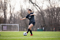 LOUISVILLE, KY - MARCH 13: Grace Bahr #32 of Racing Louisville FC passes the ball during a game between West Virginia University and Racing Louisville FC at Thurman Hutchins Park on March 13, 2021 in Louisville, Kentucky.