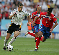 JUNE 9, 2006: Munich, Germany: Costa Rican defender (4) Michael Umana tries to catch up to German forward (11) Miroslav Klose during the World Cup Finals in Munich, Germany. Germany defeated Costa Rica, 4-2.