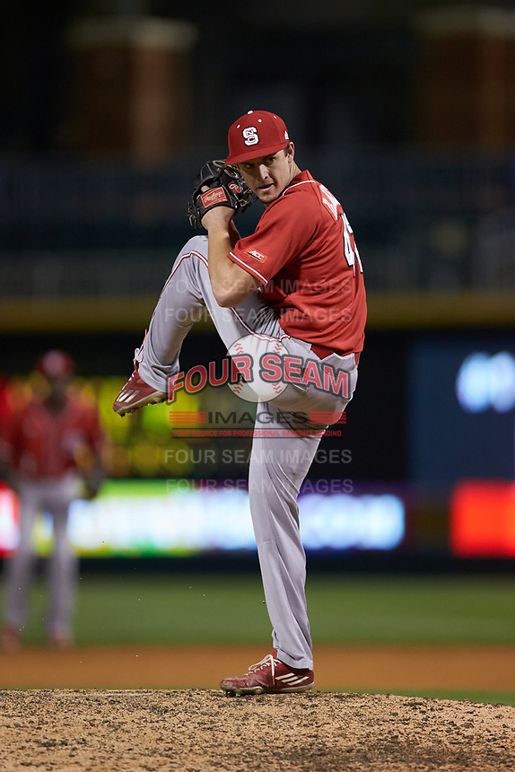 North Carolina State Wolfpack relief pitcher Tommy DeJuneas (42) in action against the Charlotte 49ers at BB&T Ballpark on March 29, 2016 in Charlotte, North Carolina. The Wolfpack defeated the 49ers 7-1.  (Brian Westerholt/Four Seam Images)