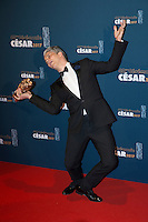 """French actor James Thierree poses with his trophy during a photocall after winning the Best Actor in a Supporting Role award for """"Chocolat"""" during the 42nd edition of the Cesar"""