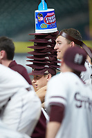 James Basham (29) of the Mississippi State Bulldogs wears a stack of rally caps during extra innings against the Houston Cougars in game six of the 2018 Shriners Hospitals for Children College Classic at Minute Maid Park on March 3, 2018 in Houston, Texas. The Bulldogs defeated the Cougars 3-2 in 12 innings. (Brian Westerholt/Four Seam Images)