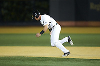 Chris Lanzilli (24) of the Wake Forest Demon Deacons takes off for second base during the game against the North Carolina State Wolfpack at David F. Couch Ballpark on April 18, 2019 in  Winston-Salem, North Carolina. The Demon Deacons defeated the Wolfpack 7-3. (Brian Westerholt/Four Seam Images)