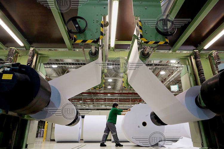 Workers operate on the paper production line at the UPM Changshu Paper Mill. UPM Changshu is the single largest investment by a Finnish company in China.