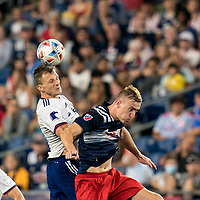 FOXBOROUGH, MA - AUGUST 18: Frederic Brillant #13 of D.C. United and Adam Buksa #9 of New England Revolution battle for head ball during a game between D.C. United and New England Revolution at Gillette Stadium on August 18, 2021 in Foxborough, Massachusetts.