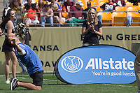 An Allstate field goal contestant celebrates after successfully kicking a 20-yard field goal. The Pitt Panthers defeated the Virginia Tech Hokies 35-17 at Heinz field in Pittsburgh, PA on September 15, 2012.