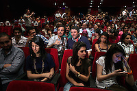 A television presenter interviews a member of the audience during the premiere of director Joud Said's latest film, 'My Last Friend', in Al-Kindi Cinema in Mashru Dummar, Damascus, Syria.