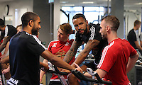 Pictured: Ashley Williams (L) and Kyle Bartley (3rd L) Sunday 28 June 2015<br />