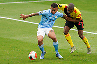 Gabriel Jesus of Man City holds off Christian Kabasele of Watford during the Premier League match between Watford and Manchester City at Vicarage Road, Watford, England on 21 July 2020. Football Stadiums around remain empty due to the Covid-19 Pandemic as Government social distancing laws prohibit supporters inside venues resulting in all fixtures being played behind closed doors until further notice.<br /> Photo by Andy Rowland.