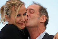 """CANNES, FRANCE - JULY 14: Agathe Rousselle and Vincent Lindon at the """"Titane"""" photocall during the 74th annual Cannes Film Festival on July 14, 2021 in Cannes, France. <br /> CAP/GOL<br /> ©GOL/Capital Pictures"""