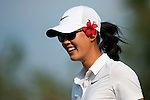 CHON BURI, THAILAND - FEBRUARY 18:  Michelle Wie of USa smiles on the 18th tee during day two of the LPGA Thailand at Siam Country Club on February 18, 2011 in Chon Buri, Thailand. Photo by Victor Fraile / The Power of Sport Images
