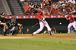 Kevin Frandsen of the Angels swings at a fastball against the White Sox.
