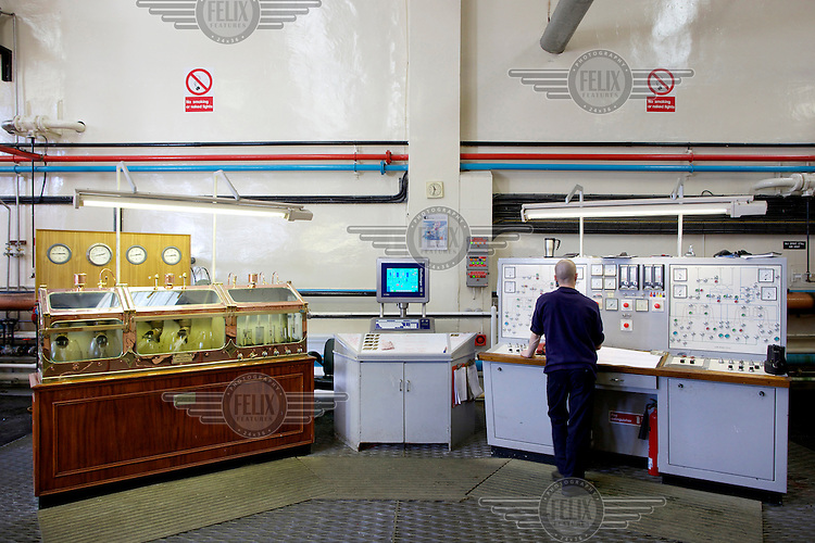 A worker monitors the whiskey production using a computer at the Glenfarclas distillery in Ballindalloch, Banffshire. The distillery is owned by the Grant family, an increasingly rare situation as multinationals have bought up many of the smaller distilleries. /Felix Features