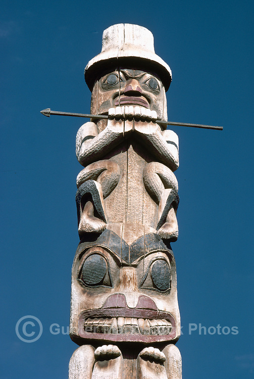 Gitxsan (Gitksan aka Tsimshian) Totem Pole, Ksan Historical Village and Museum in Hazelton, Northern BC, British Columbia, Canada - Male Figure sits atop Bear