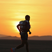 6th October 2021; Etape Mystere ;  Marathon des Sables, stage 4 of  a six-day, 251 km ultramarathon, which is approximately the distance of six regular marathons. The longest single stage is 82 km long. This multiday race is held every year in southern Morocco, in the Sahara Desert. Rachid El Morabity covers the final few kilometres to lead the race