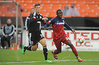 Washington, D.C.- March 29, 2014. Jhon Kennedy Hurtado of the Chicago Fire shield the ball from Conor Doyle (30) of D.C. United.  The Chicago Fire tied D.C. United 2-2 during a Major League Soccer Match for the 2014 season at RFK Stadium.