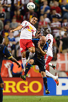 Tim Cahill (17) and Ibrahim Sekagya (32) of the New York Red Bulls goes up for a header with Conor Casey (6) of the Philadelphia Union. The New York Red Bulls and the Philadelphia Union played to a 0-0 tie during a Major League Soccer (MLS) match at Red Bull Arena in Harrison, NJ, on August 17, 2013.
