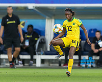 GRENOBLE, FRANCE - JUNE 18: Sashana Campbell #12 of the Jamaican National Team controls the ball during a game between Jamaica and Australia at Stade des Alpes on June 18, 2019 in Grenoble, France.