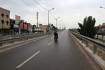 A view shows streets almost deserted during a home confinement order as a precaution against the spread of the coronavirus disease (COVID-19) in Baghdad, Iraq, on Marchl 27, 2020. Photo by Anas Jomaa