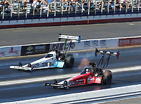 Nov 16, 2019; Pomona, CA, USA; NHRA top fuel driver Doug Kalitta (near) races alongside Justin Ashley during qualifying for the Auto Club Finals at Auto Club Raceway at Pomona. Mandatory Credit: Mark J. Rebilas-USA TODAY Sports