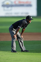 Umpire Darrell Roberts handles the calls on the bases during the Appalachian League game between the Johnson City Cardinals and the Elizabethton Twins at Joe O'Brien Field on July 11, 2015 in Elizabethton, Tennessee.  The Twins defeated the Cardinals 5-1. (Brian Westerholt/Four Seam Images)