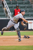 Braeden Schlehuber #23 of the Rome Braves makes a throw to first base following a dropped third strike versus the Kannapolis Intimidators at Fieldcrest Cannon Stadium July 28, 2009 in Kannapolis, North Carolina. (Photo by Brian Westerholt / Four Seam Images)