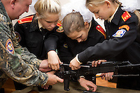 RUSSIA, Moscow, 10.2010. ©  Sergey Kozmin/EST&OST.The Moscow Girls Cadet Boarding School..At lessons of Fundamentals of Military Service the cadets have to study the most common types of weapons. The girls are assembling an RPK-74 light machine gun.