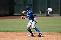 Kansas City Royals third baseman Gabriel Cancel (14) prepares to make a throw to first base during an Instructional League game against the Arizona Diamondbacks at Chase Field on October 14, 2017 in Scottsdale, Arizona. (Zachary Lucy/Four Seam Images)