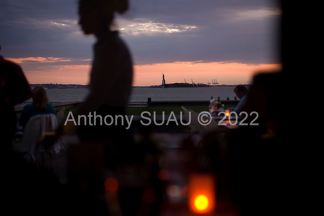 New York, New York<br /> October 16, 2011<br /> <br /> View from lower Manhattan, of the Statue of Liberty at dusk from Robert F. Wagner, Jr. Park.