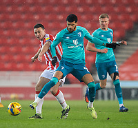 2nd January 2021; Bet365 Stadium, Stoke, Staffordshire, England; English Football League Championship Football, Stoke City versus Bournemouth; James Chester of Stoke City and Dominic Solanke of Bournemouth look for the ball